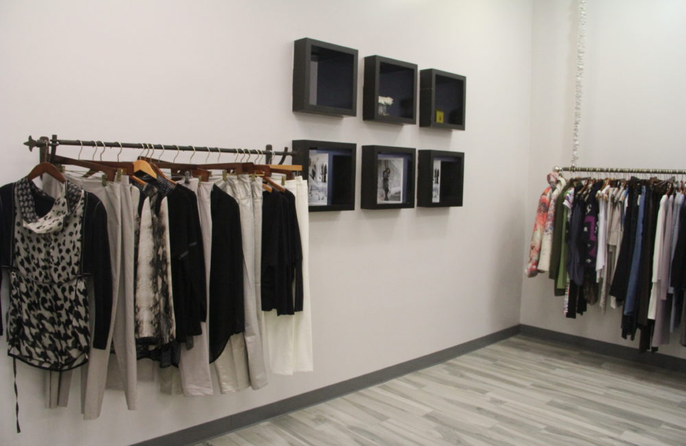 Racks of clothes inside Jbat Boutique